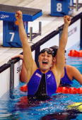 Misty Hyman of the USA celebrates gold in the Women's 200m Butterfly Final at the Sydney International Aquatic Centre on Day Five of the Sydney 2000...