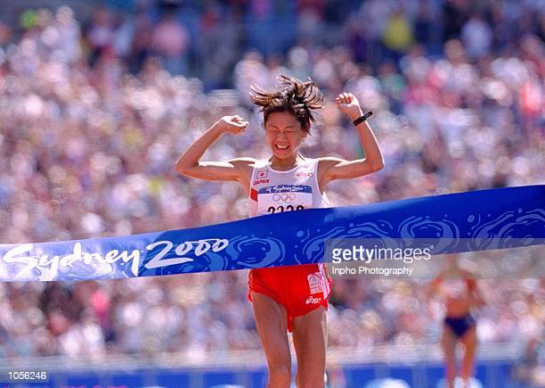 Naoko Takahashi of Japan wins the Womens Marathon on Day Nine of the Sydney 2000 Olympic Games in Sydney Australia Mandatory Credit Billy Stickland...