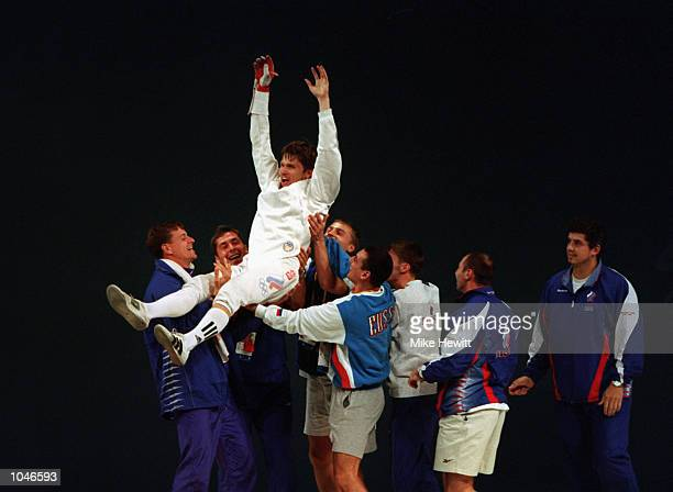 Pavel Kolobkov of Russia celebrates winning the Gold Medal by defeating Hugues Obry of France during the Mens Individual Epee Fencing Final at the...