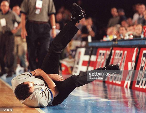 Referee Bill Mildenhall goes to ground injured unable to complete the game during the mens basketball match between the Australian Boomers and Team...