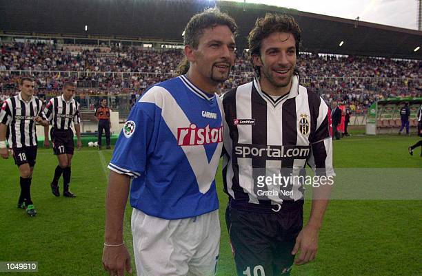 Roberto Baggio of Brescia and Alessandro Del Piero of Juventus talk before the start of the match during his debut in the Coppa Italia first leg...