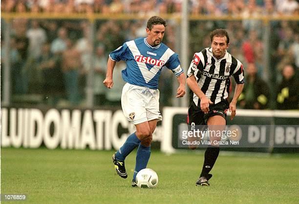 Roberto Baggio of Brescia takes the ball past Antonio Conte of Juventus during the Coppa Italia match played at the Estadio Rigamonti in Brescia...
