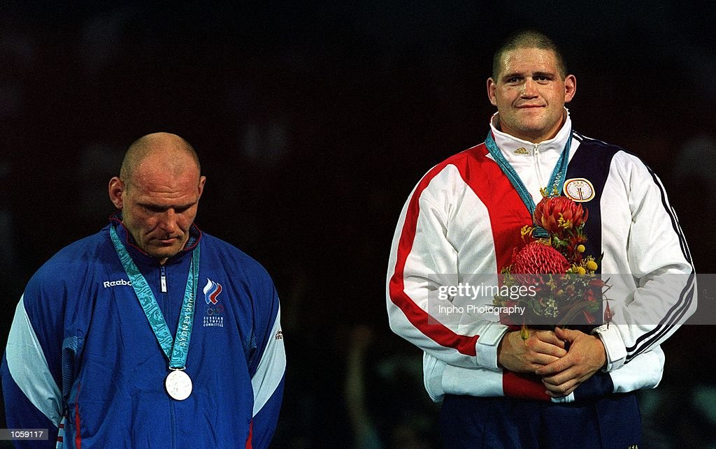 Rulon Gardner of USA celebrates winning the gold medal by defeating Alexandre Kareline of Russia in the 130 kilogram event during the Greco Roman...