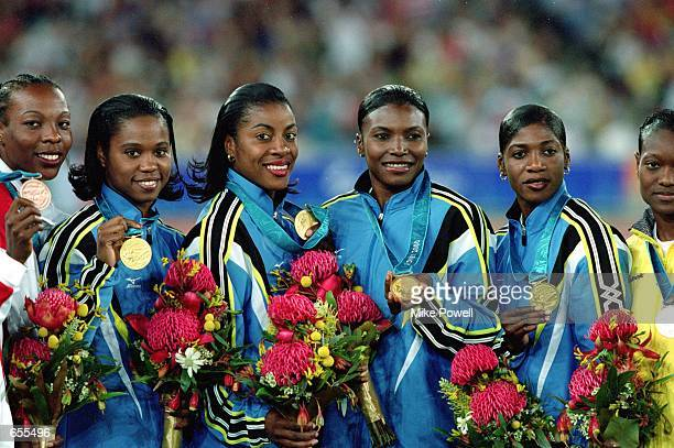 Sevatheda Fynes Chandra Sturrup Pauline Davis Thompson Debbie Ferguson of the Bahamas smiles as they receive the Gold Medal in the Womens 4x100m...