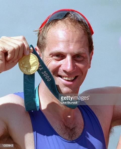 Steve Redgrave of Great Britain celebrates after making it five golds in five games after the Men's Coxless Four Rowing Final at the Sydney...