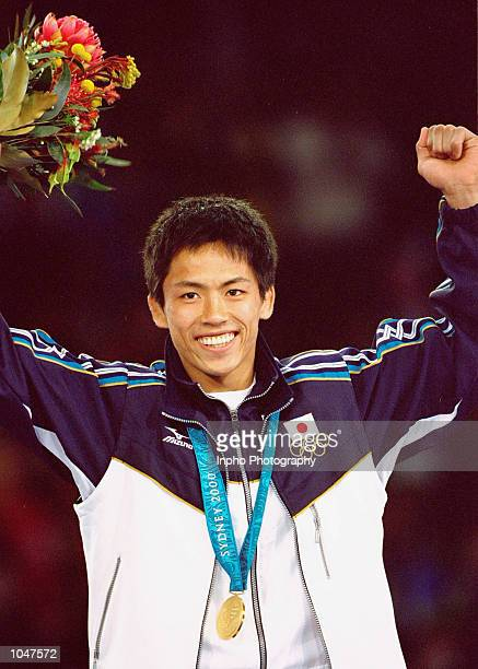 Tadahiro Nomura of Japan celebrates gold in the Men's 60kg Judo event at the Exhibition Halls in Darling Harbour on Day Two of the Sydney 2000...