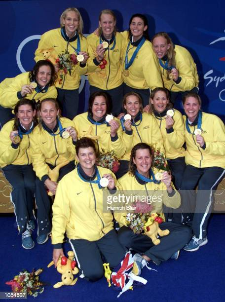 The Australian team celebrate their Gold medal win in the Women's Water Polo match between Australia and the USA at the Sydney 2000 Olympic Games...