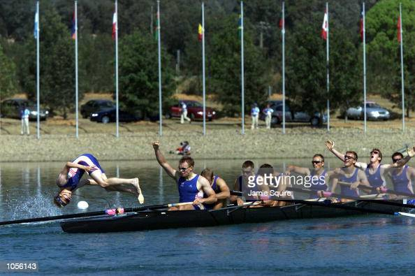 The British team celebrate winning the gold medal in the Men's Eight as cox Rowley Douglas dives in to the lake during the Sydney 2000 Olympic Games...