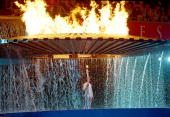 The Cauldron containing the Olympic Flame rises above Torch Bearer Cathy Freeman of Australia during the Opening Ceremony of the Sydney 2000 Olympic...
