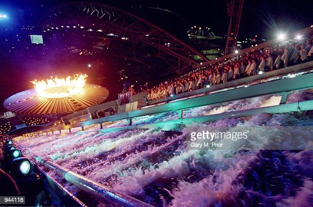 The Olympic Flame is lit during the Opening Ceremony of the Sydney 2000 Olympic Games at the Olympic Stadium in Homebush Bay Sydney Australia...