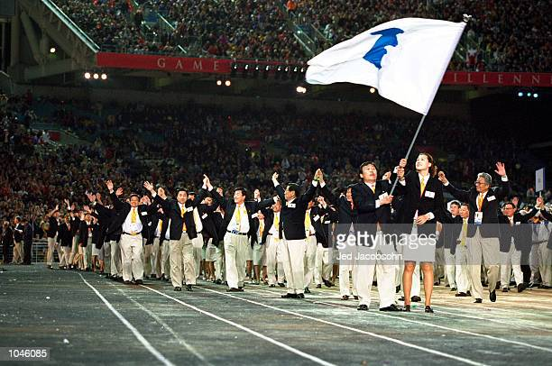 The two Korean Olympic teams walk round together under the same flag in a gesture of reconciliation during the Opening Ceremony of the Sydney 2000...