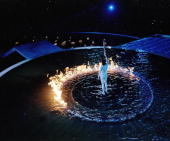 Torch Bearer Cathy Freeman of Australia lights the Cauldron with the Olympic Flame during the Opening Ceremony of the Sydney 2000 Olympic Games at...
