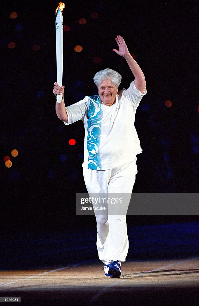 Torch Bearer Dawn Fraser of Australia acknowledges the crowd during the Opening Ceremony of the Sydney 2000 Olympic Games at the Olympic Stadium in Homebush Bay, Sydney, Australia. Mandatory Credit: Jamie Squire /Allsport