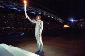 Torchbearer Cathy Freeman of Australia prepares to light the Olympic Flame during the Opening Ceremony of the Sydney 2000 Olympic Games at the...