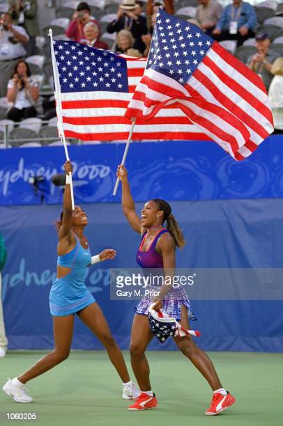 Venus and Serena Williams of the USA celebrate gold after winning the Womens Doubles Tennis Final at the NSW Tennis Centre on Day 13 of the Sydney...