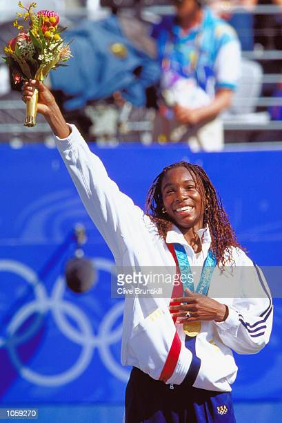 Venus Williams of the USA celebrates gold after victory in the Womens Tennis Singles Final at the NSW Tennis Centre on Day 12 of the Sydney 2000...
