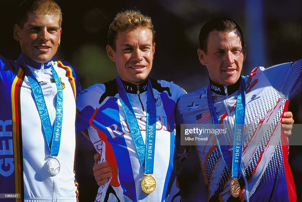 Viacheslav Ekimov of Russia celebrates gold in the Mens Road Cycling Individual Time Trial alongside silver winner Jan Ullrich of Germany and bronze medallist Lance Armstrong of the USA at Moore Park on day 15 of the Sydney 2000 Olympic Games in Sydney, Australia. \ Mandatory Credit: Mike Powell /Allsport