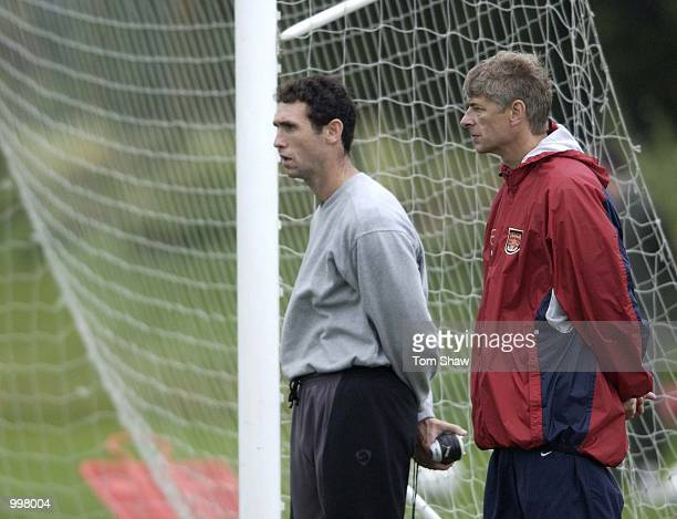 Arsene Wenger the Arsenal coach and Martin Keown look on during Arsenals training session at London Colney Training Groung London DIGITAL IMAGE...