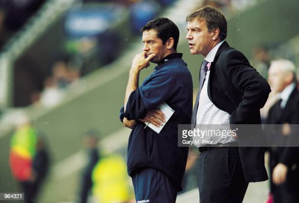 Bolton Wanderers Manager Sam Allardyce and Coach Phil Brown watch the action during the FA Barclaycard Premiership match between Bolton Wanderers and...