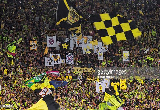 Borussia Dortmund fans cheer their team on during the German Bundesliga match between Borussia Dortmund and Bayern Munich played at the...