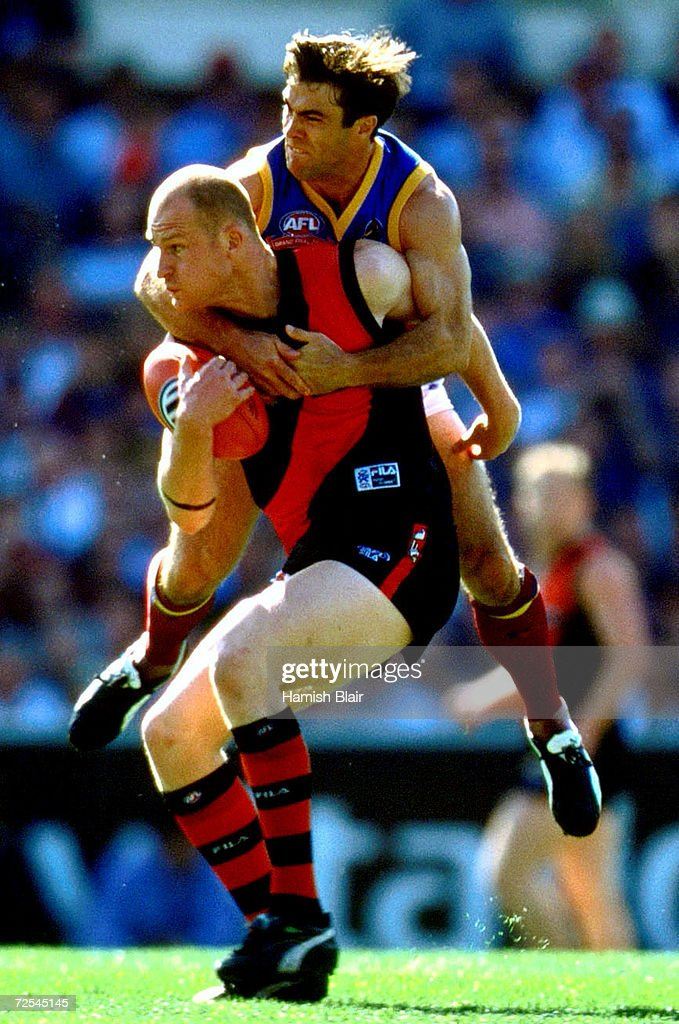 Brad Scott for Brisbane leaps on the back of Sean Wellman for Essendon during the 2001 AFL Grand Final match between the Essendon Bombers and the...