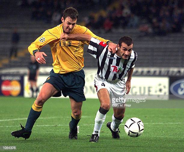 Chris Sutton of Celtic and Paolo Montero of Juventus in action during the match between Juventus and Celtic in the Champions League first group stage...