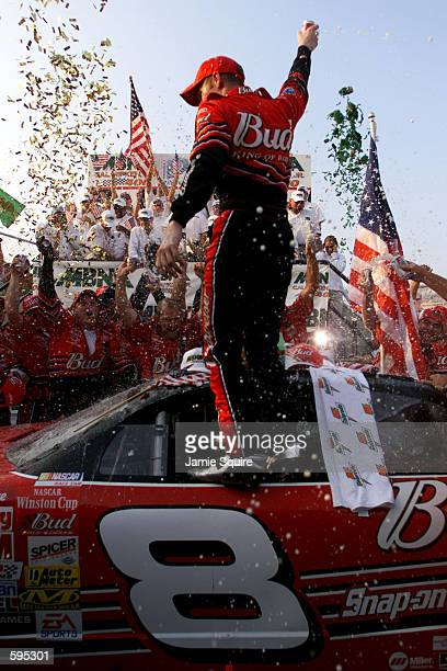 Dale Earnhardt Jr stands victoriously on his Budweiser Cheverolet Monte Carlo following his win in the MBNACal Ripken Jr 400 at Dover Downs...