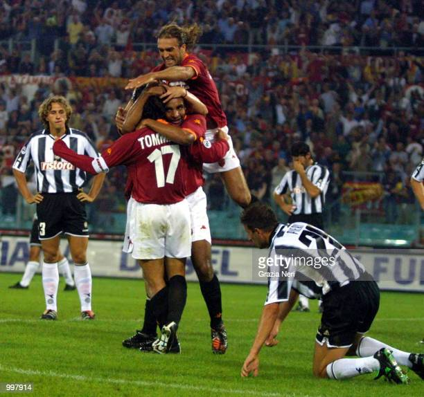 Damiano Tommasi of Roma celebrates with team mates Gabriel Batistuta and Ferreira de Rosa Emerson after scoring during the SERIE A 2nd Round League...