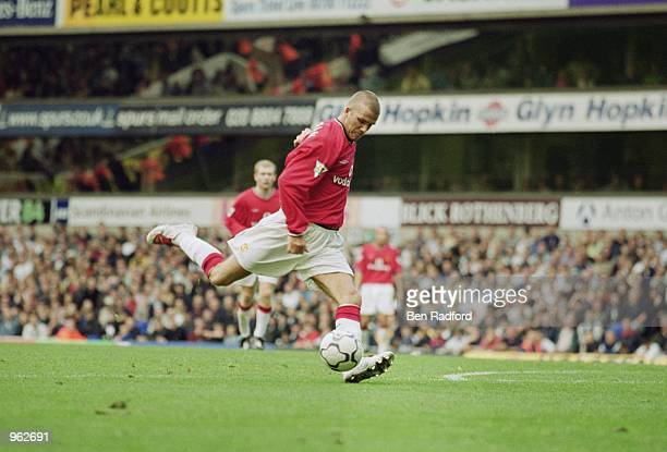 David Beckham of Man Utd shoots to score their 5th and final goal during the FA Barclaycard Premiership match between Manchester United and Tottenham...