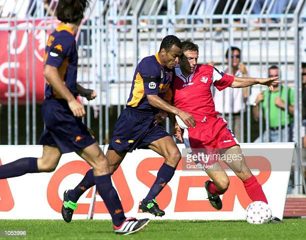 Di Francesco of Piacenza and Emerson of Roma in action during the Serie A 3rd Round League match between Piacenza and Roma played at the Galleana...