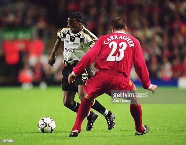 Duda of Boavista takes the ball past Jamie Carragher of Liverpool during the UEFA Champions League Group B match played at Anfield in Liverpool...