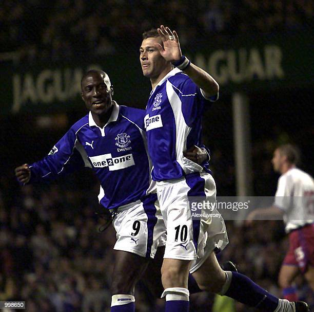 Duncan Ferguson of Everton celebrates his goal with Kevin Campbell against Crystal Palace during the Worthington Cup Second Round match between...