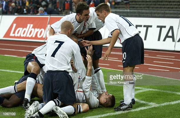 England celebrate as they go on the rampage during the FIFA World Cup 2002 Group Nine Qualifying match against Germany played at the Olympic Stadium...
