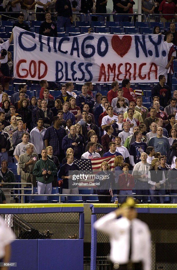 Fans hold up a 'Chicago Loves New York/God Bless America' sign before the NY Yankees take on the Chicago White Sox at Comiskey Park in Chicago IL...