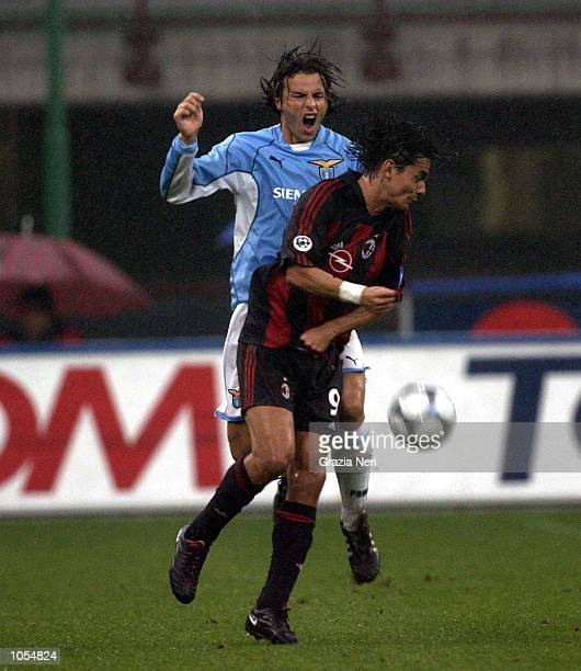 Filippo Inzaghi of AC Milan and Francesco Colonnese of Lazio clash during the Serie A 4th Round League match between AC Milan and Lazio played at the...