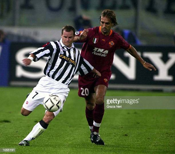 Gianluca Pessotto of Juventus is challenged by Roma's Gabriel Batistuta during the Serie A match between Juventus and Roma at the Stadio Delle Alpi...