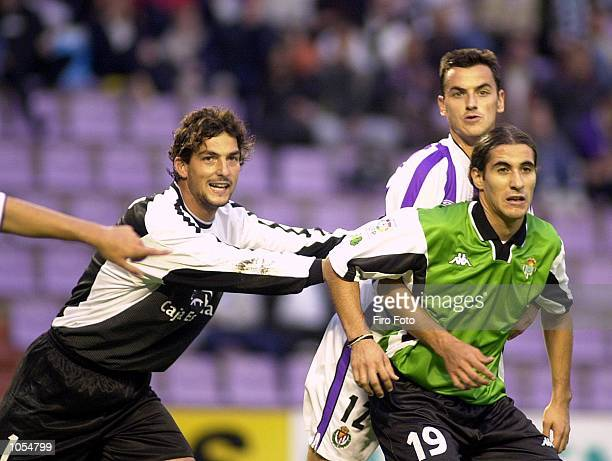 Goalkeeper Ricardo and Tena of Valladolid clash with Casas of Betis during the Primera Liga match between Valladolid and Real Betis at the Jose...