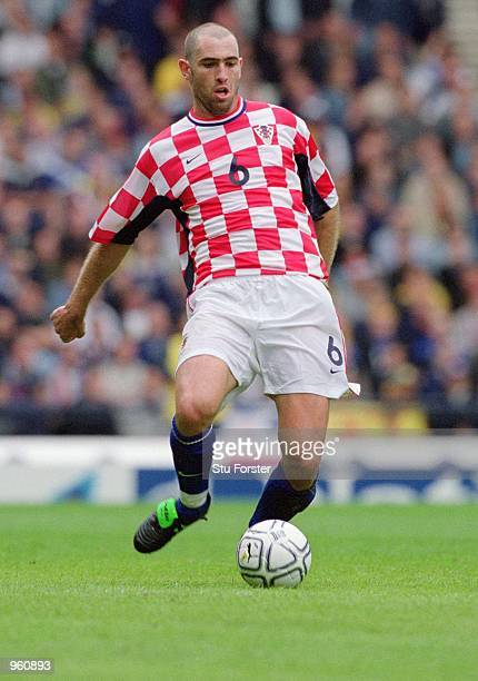 Igor Tudor of Croatia passes the ball during the FIFA 2002 World Cup Qualifier against Scotland played at Hampden Park in Glasgow Scotland The match...