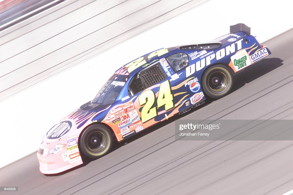 Jeff Gordon drives en route during the NASCAR Winston Cup Series Protection One 400 at Kansas Speedway in Kansas City Kansas DIGITAL IMAGE Mandatory...