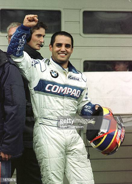 Juan Pablo Montoya of Colombia and Williams celebrates taking pole position during qualifying for the Formula One Belgian Grand Prix at Spa...