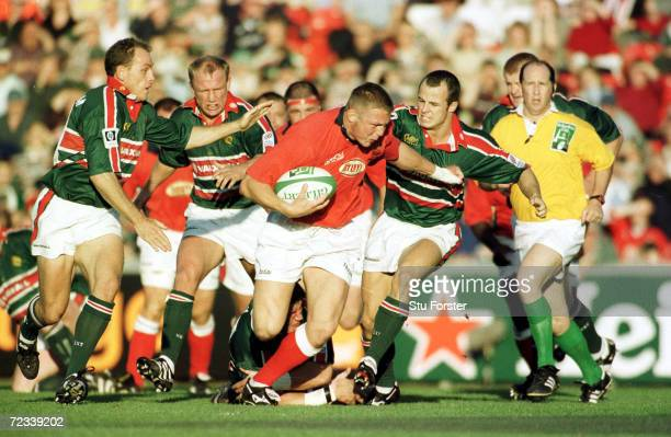 Leicester's Austin Healey tackles Llanelli's Dafydd Jones during the Heineken Cup match between Leicester Tigers and Llanelli at Welford Road...