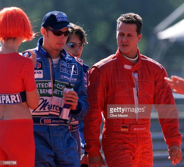 Michael Schumacher of Germany and Ferrari talks with Jenson Button of Benetton and Great Britain during the drivers parade before the Italian Grand...