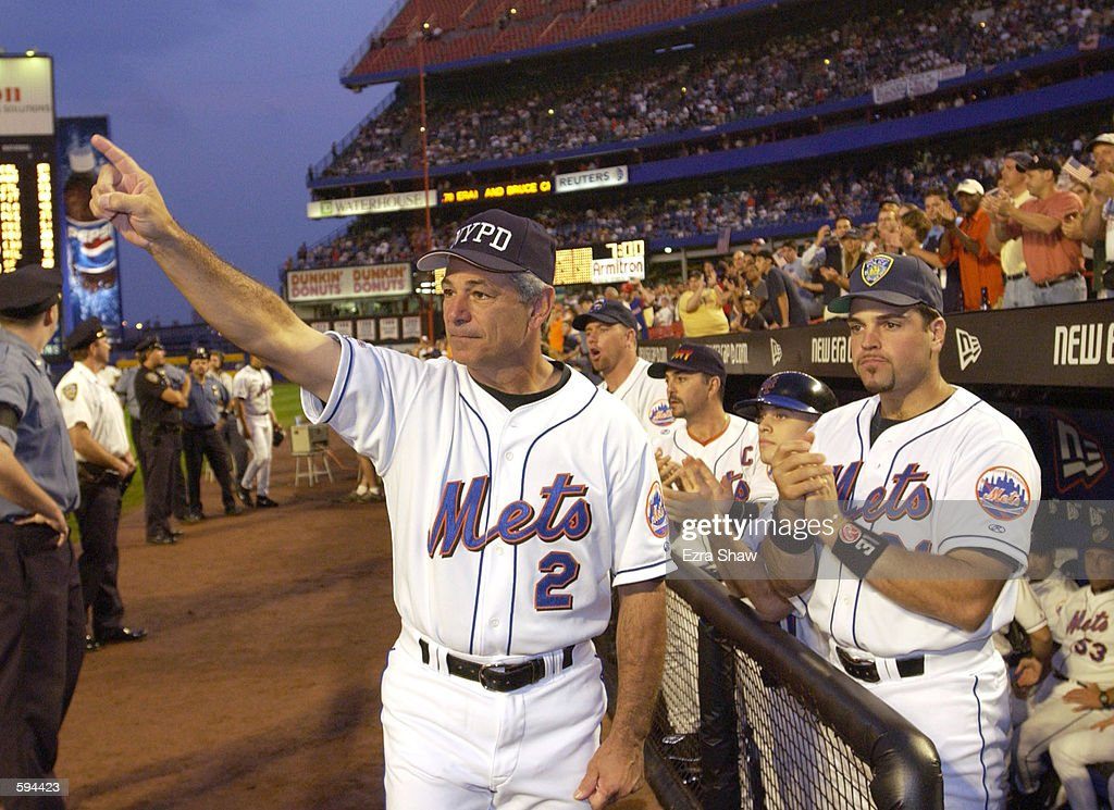 New York Mets manager Bobby Valentine and catcher Mike Piazza applaude in honor of New York City Mayor Rudy Giuliani before the Mets game against the...