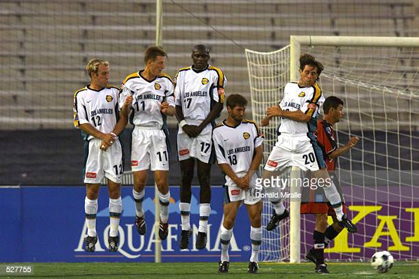 Players of the Los Angeles Galaxy form a wall to defend against a penalty kick during the match against the New York/ New Jersey MetroStars at the...