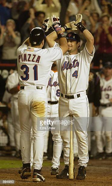 Robin Ventura of the New York Mets congratulates Mike Piazza after Piazza hit a 2run home run in the eighth inning of the Mets game against the...