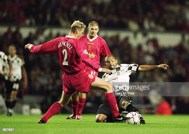Stephane Henchoz of Liverpool goes for the loose ball with Silva of Boavista during the UEFA Champions League Group B match played at Anfield in...