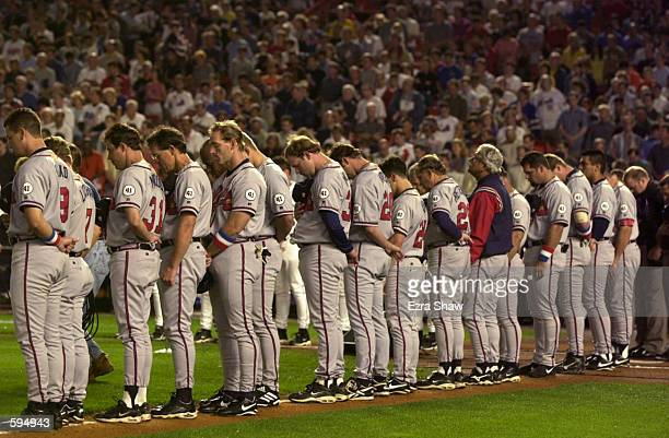 The Atlanta Braves observe a moment of silence before the Mets game against the Atlanta Braves at Shea Stadium in Flushing New York <DIGITAL IMAGE>...