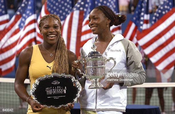 Venus Williams holds her trophy with her sister Serena Williams after the women's final match of the US Open at the USTA National Tennis Center in...