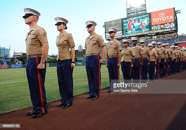 Members of the US Marine Corps get ready to walk onto the field for the national anthem during 911 remembrance night before the start of a game...
