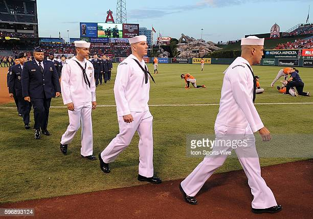 Members of the US Navy walk off the field after the national anthem during 911 remembrance night before the start of a game between the Houston...
